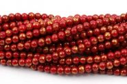 Mashan jade Rød med guld 4 mm