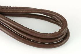 Randsyet imiteret lammeskind 7x6 mm mellembrun