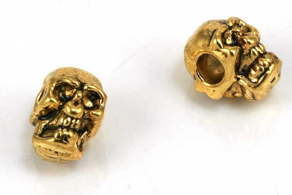 Metalperle skull 8x6 mm guldfarve